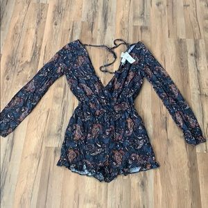 Tillys romper size small with tags still on!